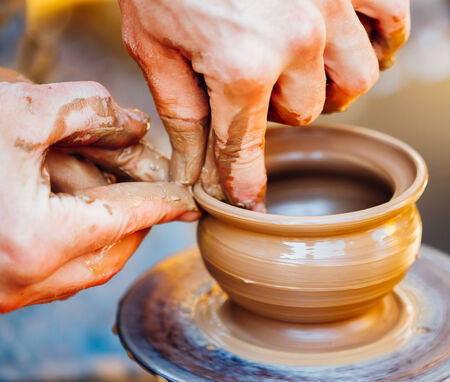 Pottery craft wheel ceramic clay potter human hand