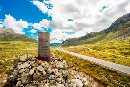 Navigation Mark Pointer Near Highway On Norwegian Mountain photo
