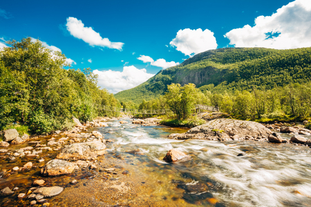 Norway Nature River. Sunny Summer Day, Landscape With Mountain, Pure Cold Water River, Pond photo