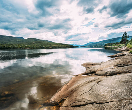 Norway Nature Fjord, Autumn Time. Cloudy Day, Landscape With Mountain, Pure Water Lake, Pond, Sea photo