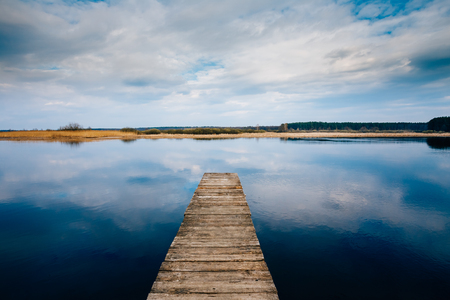 Old Wooden Pier. Calm River Nature Background Stock Photo