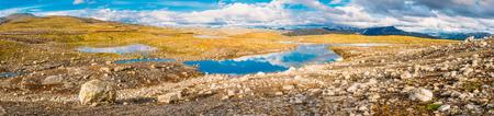 Norway Nature Landscape Panorama. Norwegian Mountains Under Sunny Blue Sky Stock Photo
