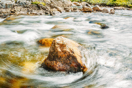 Norway Nature River. Rock Stone In Pure Cold Water Pond Stock Photo