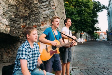 TALLINN, ESTONIA - JULY 25: Street Musicians At The Evening Near Famous Viru Gate  In Old City On July 25, 2014 In Tallinn. Viru Gates were built in the 14thC, still standing today.