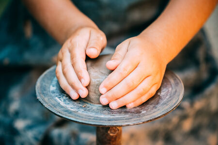 creative arts: Pottery Craft Wheel Ceramic Clay Potter Human Child Hands. Toned Instant Photo
