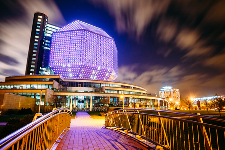 MINSK, BELARUS - JULY 19, 2014: Unique Building Of National Library Of Belarus In Minsk At Night Scene. Building Has 23 Floors And Is 72-metre High. Library can seat about 2,000 readers and features a 500-seat conference hall. Editorial