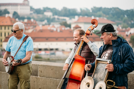 PRAGUE, CZECH REPUBLIC - OCTOBER 8, 2014: Street Buskers performing jazz songs on the Charles Bridge in Prague. Busking is legal form of earning money on Prague Streets. Editorial