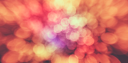 Abstract Colorful Background With Warm Orange, Red, Yellow Colors. Bokeh Lights Out Of Focus. photo