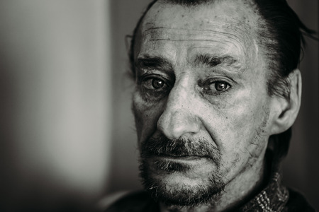 Portrait Of Serious Sad Old Adult Expressive Man With Beard Looking At Camera. Black And White, Monochrome Photo Stock Photo