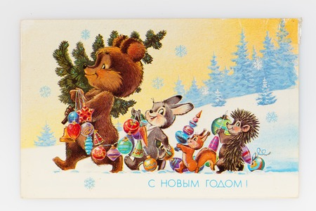 USSR - CIRCA 1990: Reproduction of antique postcard shows Bear, rabbit, squirrel and hedgehog are the Christmas tree and toys, circa 1990. Russian text: Happy New Year! (painter V. Zarubin)