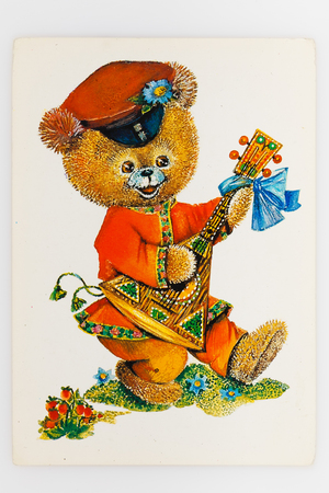 USSR - CIRCA 1989: Reproduction of antique postcard shows bear dressed in traditional red shirt (kosovorotka) plays the balalaika, circa 1989. (painter L. Manilova)
