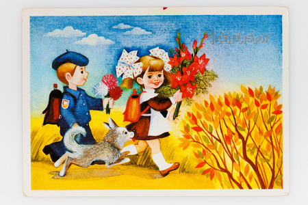 reproduction animal: USSR - CIRCA 1989: Reproduction of antique postcard shows Soviet children - a boy and a girl - go to school, circa 1989. Russian text: 1st September (painter T. Grudinina)
