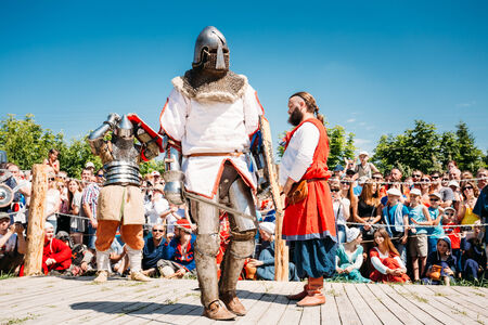 MINSK, BELARUS - JULY 19, 2014 Historical restoration of knightly fights on VI festival of medieval culture Our Grunwald, dedicated to 604 anniversary of Battle of Grunwald in Dudutki
