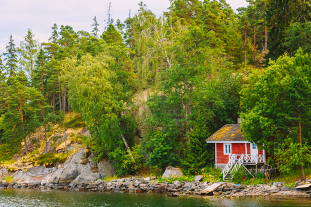 finland sauna: Red Finnish Wooden Sauna Log Cabin On Island In Summer