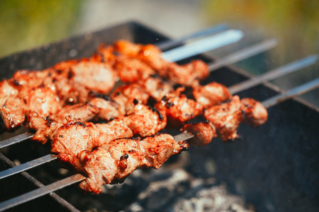 barbecue: Grilled marinated caucasus barbecue meat shashlik shish kebab pork meat grilling on metal skewer