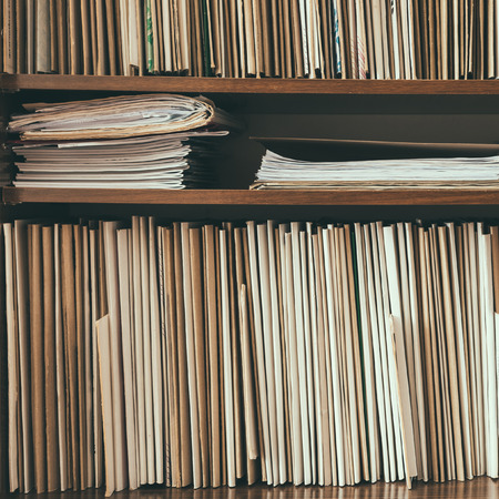 antique paper: Keeping Old Paper Records On Shelves Background Stock Photo