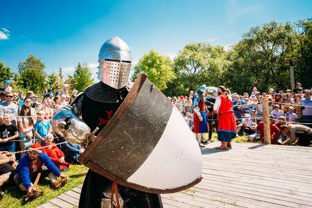 crusaders: MINSK, BELARUS - JULY 19, 2014: Winner In Battle Knight. Historical restoration of knightly fights on VI festival of medieval culture Our Grunwald, dedicated to 604 anniversary of Battle of Grunwald in Dudutki