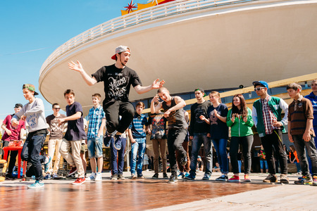 GOMEL, BELARUS - MAY 9, 2014: Battle dance youth teams at the city festival. Street performer break dances for the crowd