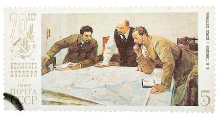 generals: USSR - CIRCA 1987: Stamp printed in Russia shows Lenin planning strategy with two generals. 70th anniversary of the Russian revolution, circa 1987.