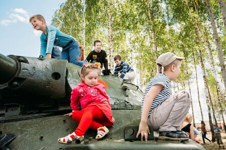 offensive: SVIETLAHORSK, BELARUS - JUNE 21, 2014: Children climb on Soviet tank from World War II during celebration events dedicated to 70th anniversary of Soviet Belorussian offensive operation Bagration.