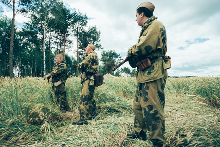 reenactmant: SVETLAHORSK, BELARUS - JUNE 21, 2014: Unidentified re-enactors dressed as Soviet Russian soldiers during events dedicated to 70th anniversary of Soviet Belorussian offensive operation Bagration. Editorial