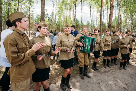 SVETLAHORSK, BELARUS - JUNE 21, 2014: Unidentified artists dressed as Soviet Russian soldiers dance during events dedicated to 70th anniversary of Soviet Belorussian offensive operation Bagration.