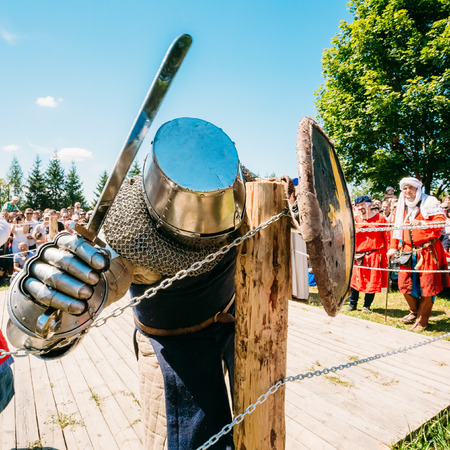 crusaders: MINSK, BELARUS - JULY 19, 2014: Historical restoration of knightly fights on festival of medieval culture Editorial