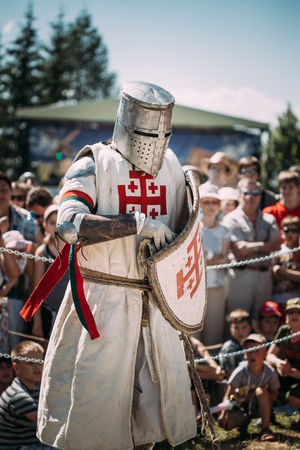 knightly: MINSK, BELARUS - JULY 19, 2014: Historical restoration of knightly fights on festival of medieval culture. Knight participant Editorial