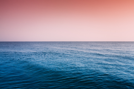 Calm Sea Ocean And Red Clear Sunset Sunrise Sky  Background