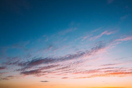 Sky, Bright Blue, Orange And Yellow Colors Sunset Sunrise. Instant Toned Photo 版權商用圖片