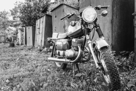 motor cycle: Old Motor Cycle Parked On Grass Yard. Vintage Generic Motorcycle Motorbike In Countryside Stock Photo