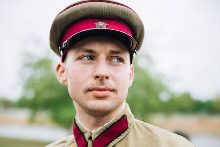 reenactmant: MOGILEV, BELARUS - MAY, 08, 2015: Unidentified re-enactor dressed as Soviet soldier during events dedicated to 70th anniversary of the liberation of Belarus from Nazi invaders and the Victory of the Soviet people in the Great Patriotic War. Editorial