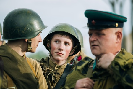 reenaction: MOGILEV, BELARUS - MAY, 08, 2015: Unidentified re-enactors dressed as Soviet soldiers during events dedicated to 70th anniversary of the liberation of Belarus from Nazi invaders and the Victory of the Soviet people in the Great Patriotic War.