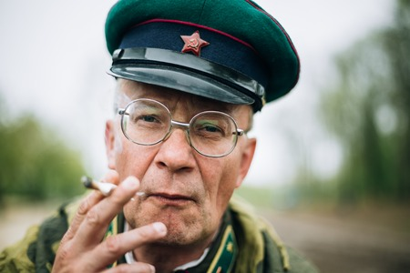 reenaction: MOGILEV, BELARUS - MAY, 08, 2015: Unidentified re-enactor dressed as Soviet soldier during events dedicated to 70th anniversary of the liberation of Belarus from Nazi invaders and the Victory of the Soviet people in the Great Patriotic War. Editorial