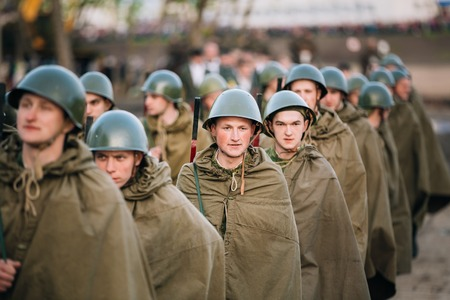 historic world event: MOGILEV, BELARUS - MAY, 08, 2015: Parade of unidentified re-enactors dressed as Soviet soldiers during events dedicated to 70th anniversary of the Victory of Soviet people in the Great Patriotic War.