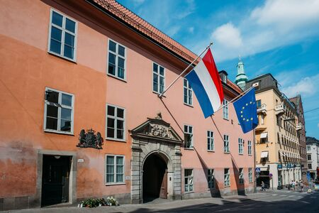 establishment states: STOCKHOLM, SWEDEN - JULY 29, 2014: French Tricolours Flag And Flag Of The European Union Decorate Building Of The Streets Of Stockholm, Sweden