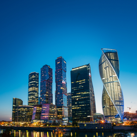 city by night: Buildings Of Moscow City Complex Of Skyscrapers At Evening In Moscow, Russia. Business Center Of Modern Moscow Stock Photo