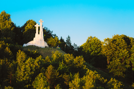 bleak: Monument of Three Crosses on the Bleak Hill at the dawn time  in Vilnius, Lithuania. Stock Photo