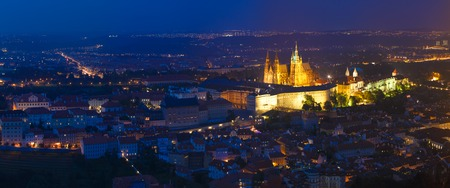 Night panorama of Prague, Czech Republic.  St. Vitus Cathedral. Panoramic night view to Lesser Town, Prague castle and St. Nicholas church.