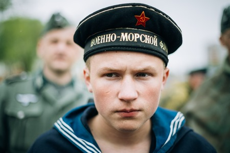 reenactor: MOGILEV, BELARUS - MAY, 08, 2015: Unidentified re-enactor dressed as Soviet sailor during events dedicated to 70th anniversary of the Victory of the Soviet people in the Great Patriotic War.