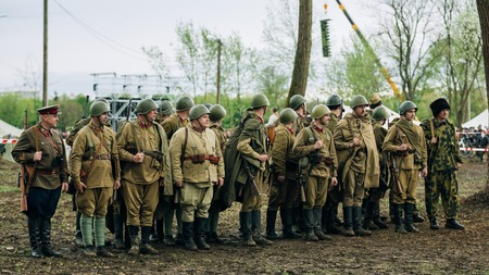 invaders: MOGILEV, BELARUS - MAY, 08, 2015: Unidentified re-enactors dressed as Soviet soldiers during events dedicated to 70th anniversary of the liberation of Belarus from Nazi invaders and the Victory of the Soviet people in the Great Patriotic War.
