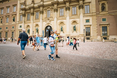 STOCKHOLM, SWEDEN - JULY 30, 2014: Tourists visit the Royal palace in Gamla Stan, where king Carl XVI Gustaf has his working office.
