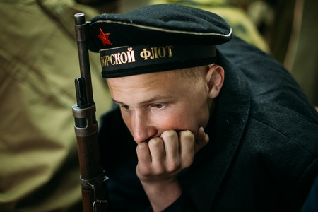 reenaction: MOGILEV, BELARUS - MAY, 08, 2015: Unidentified re-enactor dressed as Soviet sailor during events dedicated to 70th anniversary of the Victory of the Soviet people in the Great Patriotic War.