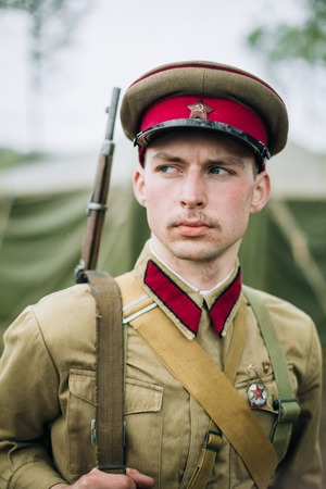 invaders: MOGILEV, BELARUS - MAY, 08, 2015: Unidentified re-enactor dressed as Soviet officer during events dedicated to 70th anniversary of the liberation of Belarus from Nazi invaders. Editorial