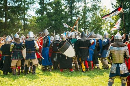 wojenne: MINSK, BELARUS - JULY 19, 2014: Historical restoration of knightly fights on festival of medieval culture Publikacyjne