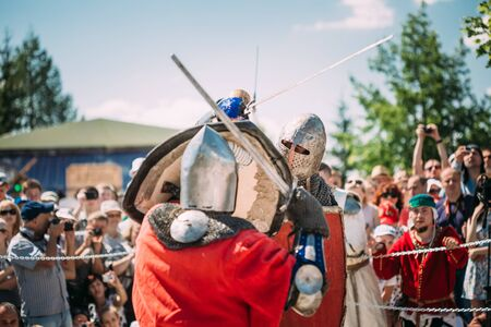 knightly: MINSK, BELARUS - JULY 19, 2014: Historical restoration of knightly fights on festival of medieval culture Editorial