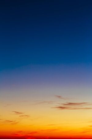 blue romance: Sky, Bright Blue, Orange And Yellow Colors Sunset. Instant Vertical Photo, Toned Image