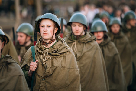 reenacting: MOGILEV, BELARUS - MAY, 08, 2015: Parade of unidentified re-enactors dressed as Soviet soldiers during events dedicated to 70th anniversary of the Victory of Soviet people in the Great Patriotic War.