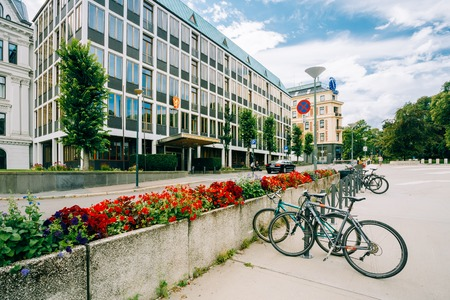 foreign affairs: OSLO, NORWAY - JULY 31, 2014: Parked Bicycle On Sidewalk near The Ministry of Foreign Affairs of Norway Editorial
