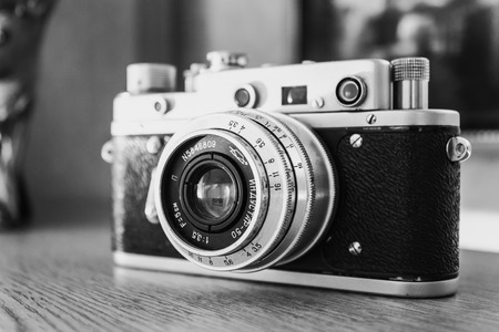 camera: MINSK, BELARUS - January 18, 2010: Russian Soviet Vintage Camera Zorkiy 2-S. Zorki 2-S is small-format rangefinder camera introduced in 1956 by KMZ factory in Russia. Stock Photo